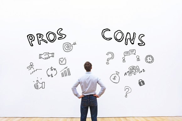 "A man, seen from behind and with hands on hips, stares at a white wall. To one side is the word ""Pros,"" and to the other ""Cons,"" with illustrations of types of pros and cons below each word."