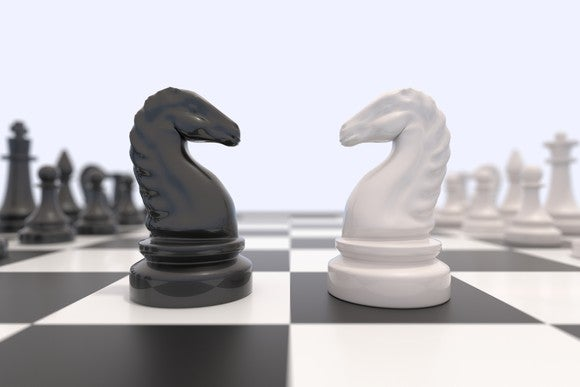 Chess pieces facing off against each other.