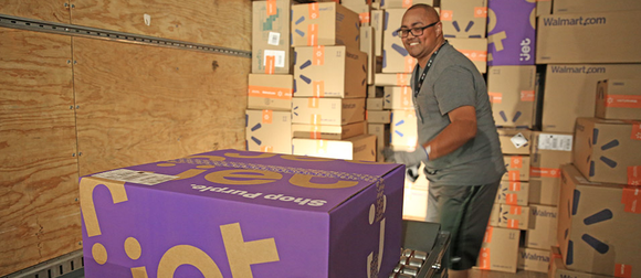 A warehouse worker gets a Jet.com box ready for shipping.