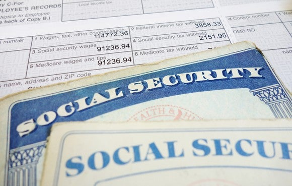 Social Security cards on top of tax forms