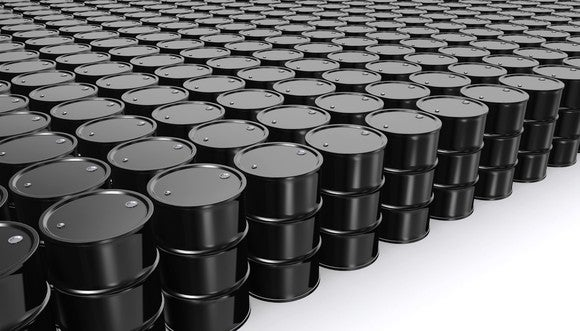 Oil barrels arranged in a grid pattern.