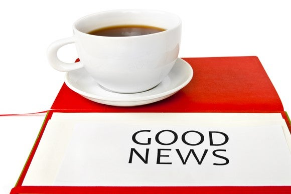 Good news printed on paper with coffee cup