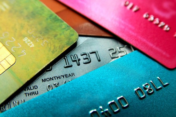 A stack of credit cards all different colors.