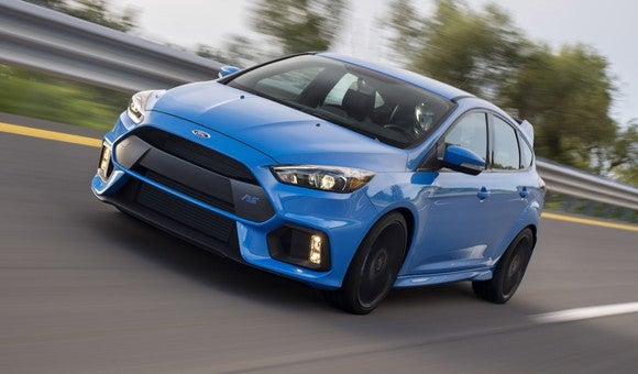 A blue 2017 Ford Focus RS on a highway.