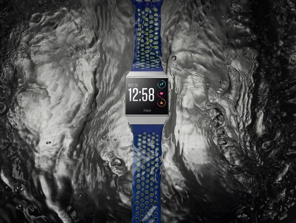 Fitbit Ionic on top of a water background.