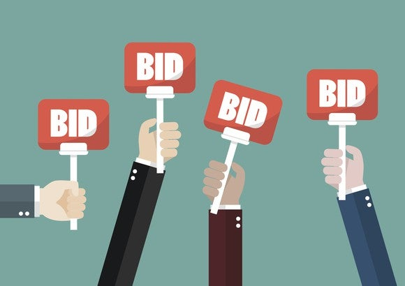 "Cartoon hands holding ""BID"" signs"