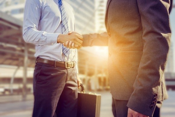 Two business professionals shaking hands