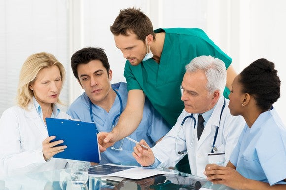 Team of doctors looking over data