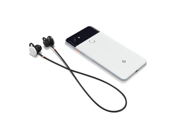 Pixel Buds next to Pixel 2 smartphone