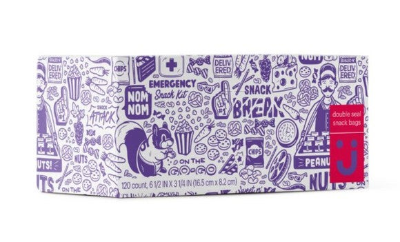 "Box with snacks with wild cartoonish drawings and sayings like ""nom nom"" and ""emergency snack kit""."