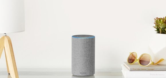 Amazon Echo sitting on a table.