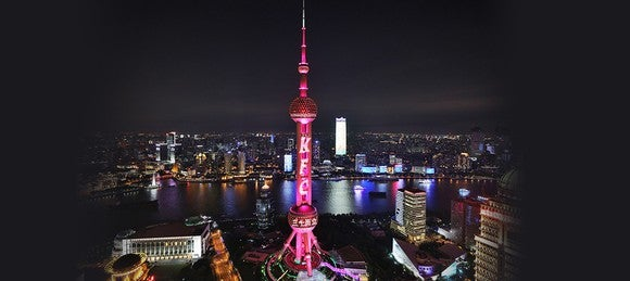 Shanghai's Pearl Tower lit up to celebrate the 30-year anniversary of KFC in China in July 2017.