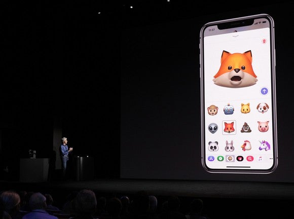 An Apple executive demonstrating the animated emoji capability of the iPhone X on stage.