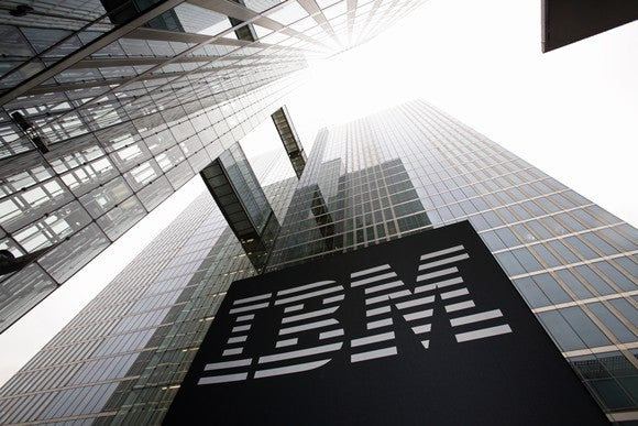 Photo of two tall, glass-clad buildings with a large IBM logo.