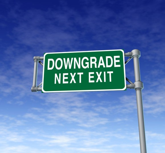 "Highway sign that reads ""Downgrade next exit"""