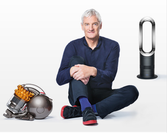 Founder James Dyson sitting amidst two of the company's products -- a vacuum and an air purifier.