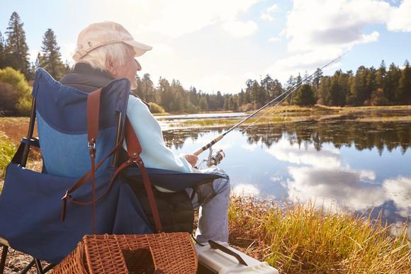 Older gentleman of retirement age fishing.