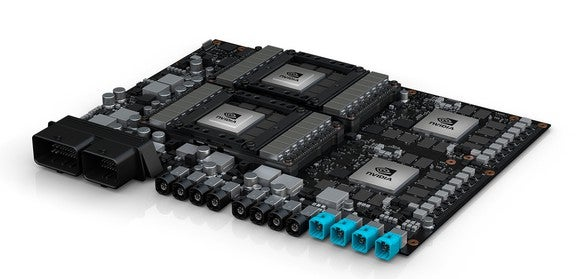 NVIDIA's Drive PX Pegasus, a circuit board with four big processor chips and a slew of plugs