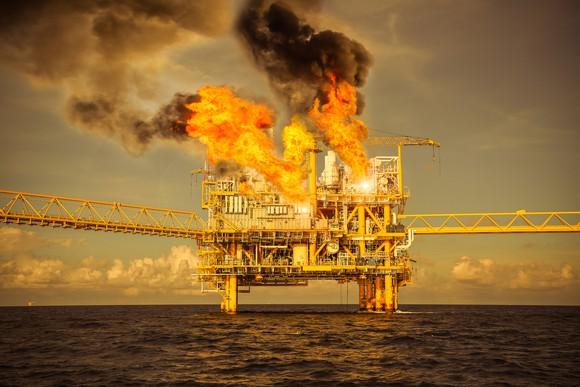 An offshore oil platform on fire.