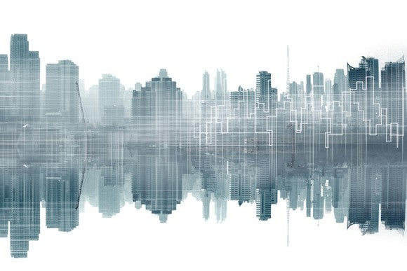 Outline of a city, reflected on to water.