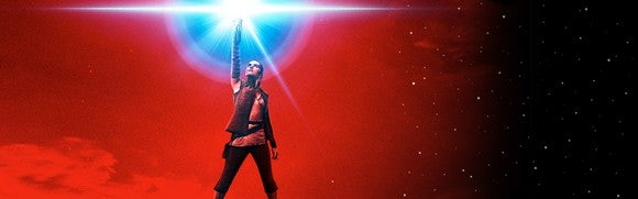 poster of Star Wars heroine Rey with arm raised holding a light saber against a red background