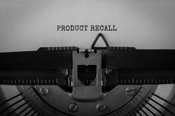 "The text ""Product Recall"" typed on a retro typerwriter."