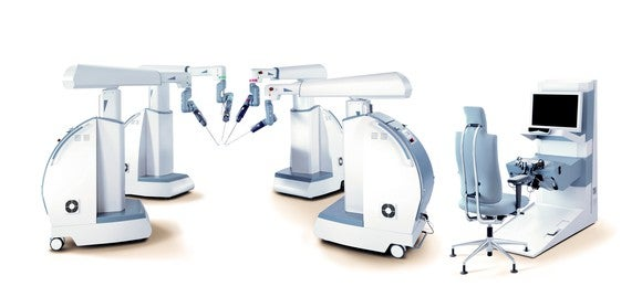 Picture of the Senhance Surgical System arms and docking station