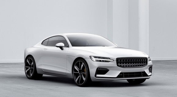 The Polestar 1, a white coupe with sporty wheels and tires and upright styling reminiscent of classic Volvos.