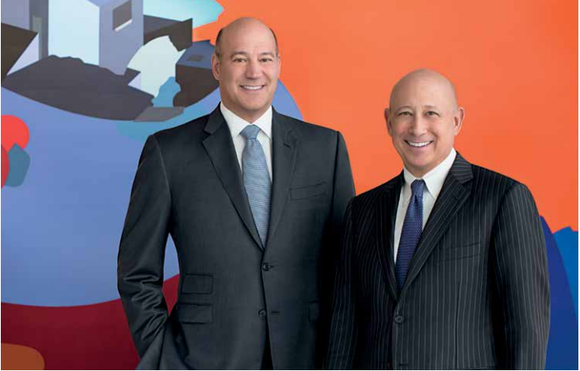 Goldman Sachs former President Gary Cohn standing with current chairman and CEO Lloyd Blankfein.