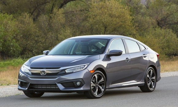 A gray Honda Civic, a compact four-door hatchback.