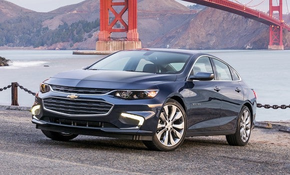 A dark blue Chevrolet Malibu midsize sedan, parked with the Golden Gate Bridge visible in the background.