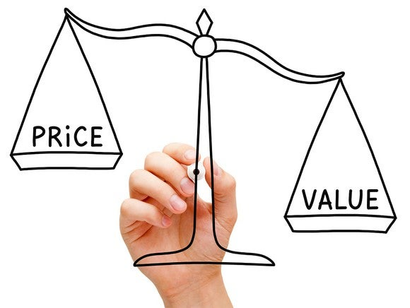 "Hand drawing a scale with ""price"" on one side, and ""value"" on the other."