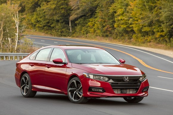 A red 2018 Honda Accord Sport, a midsize four-door sedan with a swooping roofline