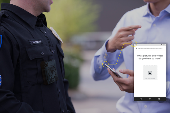 A uniformed officer, and a person in civilian dress, uploading content onto Evidence.com