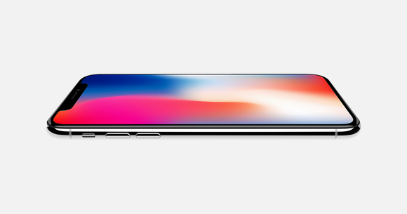 The Apple iPhone X on a flat white table.