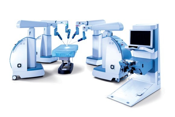 Picture of the Senhance Robotic Surgical arms and console