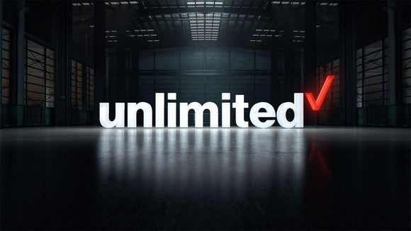 Verizon unlimited logo superimposed on a photo of an empty warehouse