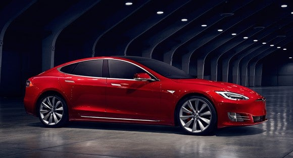 A red Tesla Model S sedan.