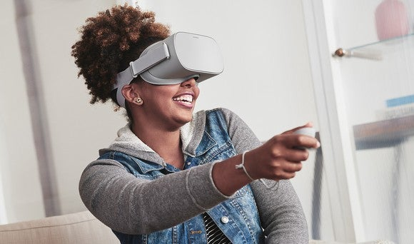 A woman uses an Oculus Go headset.