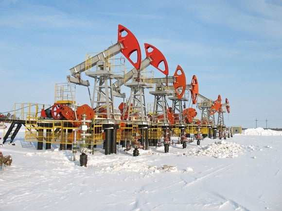 A row of oil pumps in the snow