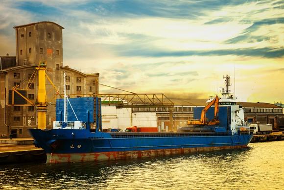 A grain ship loading at a port.
