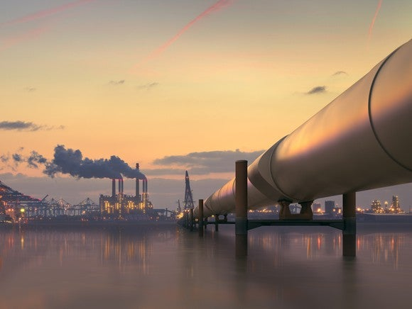 A pipeline heading to an industrial complex.