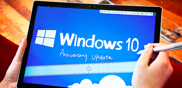 The Microsoft Windows 10 logo shown above the words Anniversary Update on a  Surface Tablet