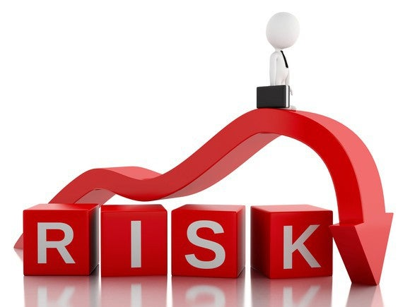 A red arrow points down over cubes spelling the word risk.
