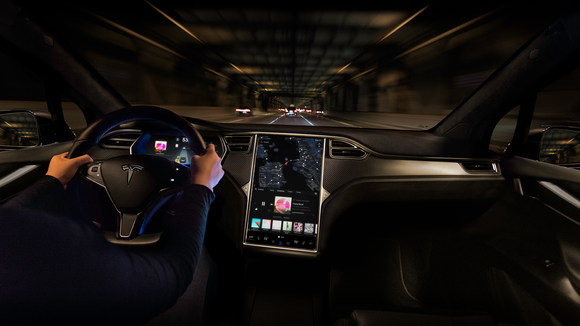 Tesla Model X interior with Autopilot activated.