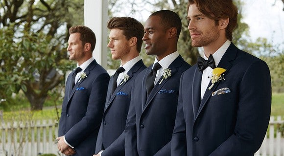 Four men wearing tuxedos.