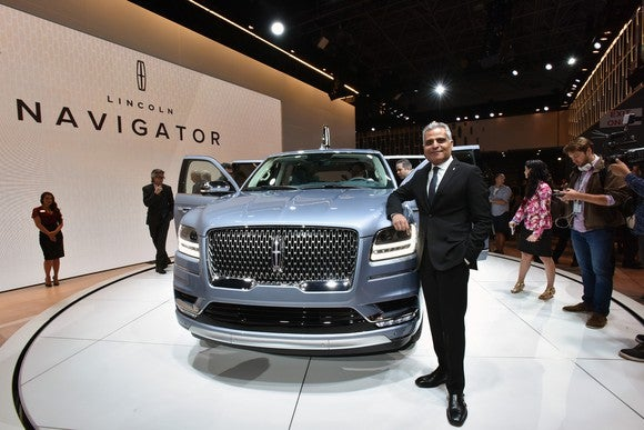 Galhotra is shown standing next to the all-new Lincoln Navigator on the Lincoln brand's show stand at the 2017 New York International Auto Show.
