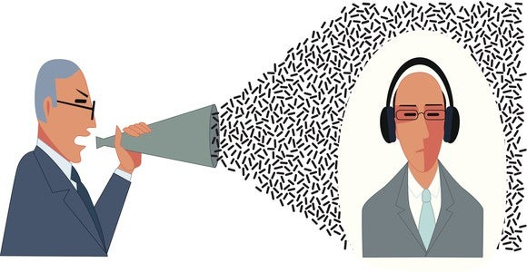 Cartoon of one man shouting into a loudspeaker while another ignores him with headphones on.