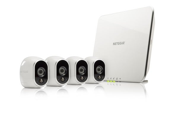 Netgear Arlo Wireless security cameras next to a Netgear router