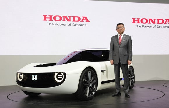 Hachigo is standing next to the Honda Sports EV Concept, a futuristic-looking curvy white coupe, on Honda's show stand at the Tokyo Motor Show on October 25, 2017.
